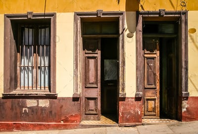Open wooden doors to old tenement house in Valparaiso
