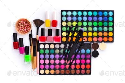 Set of decorative cosmetics and coloured nail polish bottles  on