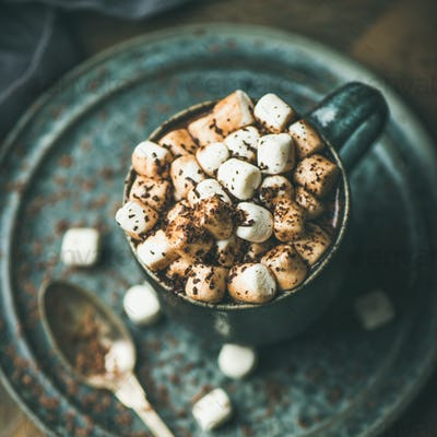 Winter warming sweet drink hot chocolate with marshmallows, square crop