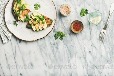 Flat-lay of avocado toast with seasoning