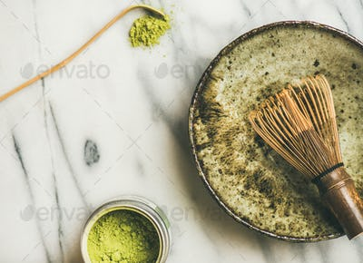 Japanese tools and bowls for brewing matcha tea, horizontal composition