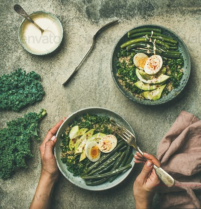 Quinoa, kale, beans, avocado, egg with creamy tahini dressing bowls