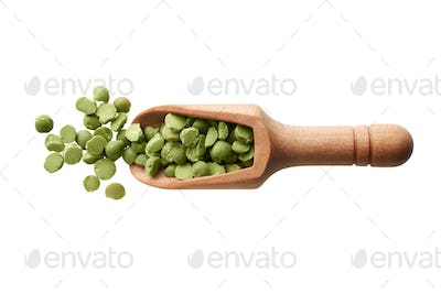 Dried green peas in a wooden scoop