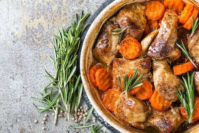 Meat baked with carrots in the oven