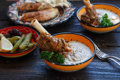 Lamb shank with puree and parsley in bowl