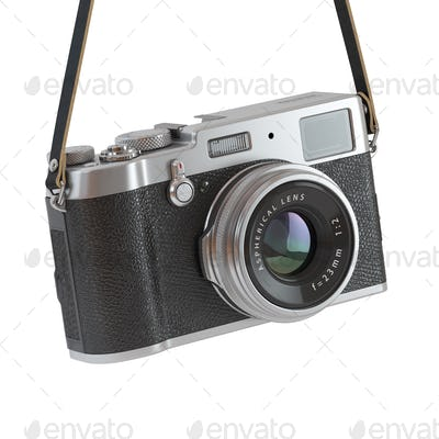 Hanging vintage retro photo camera isolated on the white backgro