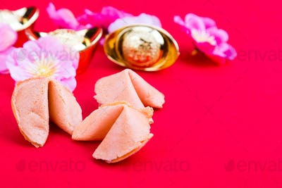 Fortune cookies, decorative gold nuggets, plum blossom flowres r