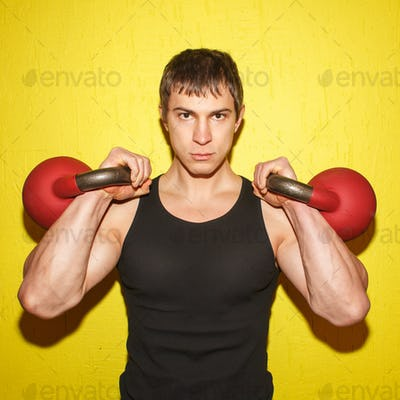 brutal muscular guy with weights isolated