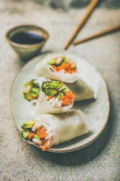 Shrimp and vegetable rice paper spring rolls on ceramic plate