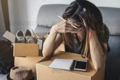 Stressed asian business woman working online business