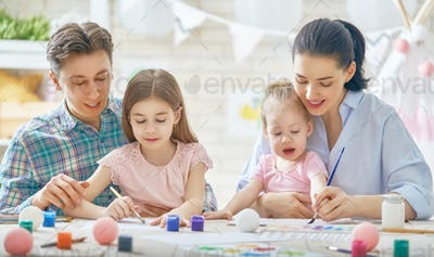 Mother, father and daughters painting