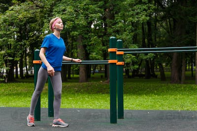 Young girl doing gymnastics in the park