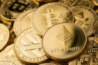 close up of ethereum litecoin and bitcoin stack of golden coins