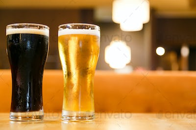 Two glasses of fresh cold beer. A glass dark and light.
