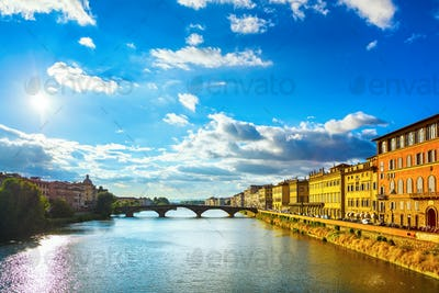 Santa Trinita Bridge on Arno river, sunset landscape. Florence,