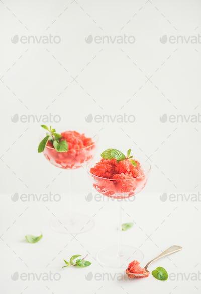 Strawberry and champaigne summer granita with mint in champagne glasses