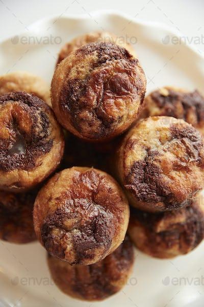 Display Of Freshly Baked Cinnamon Buns In Coffee Shop