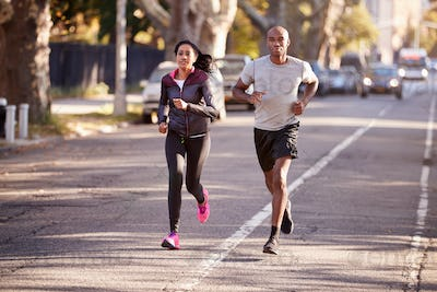 Young black couple jogging in a Brooklyn street