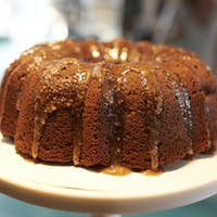 Freshly Baked Treacle Cake On Stand In Coffee Shop