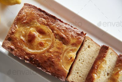 Freshly Baked Lemon Slice Cake On Stand In Coffee Shop