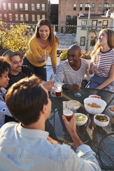 Friends having a party on a rooftop,roof terrace, vertical