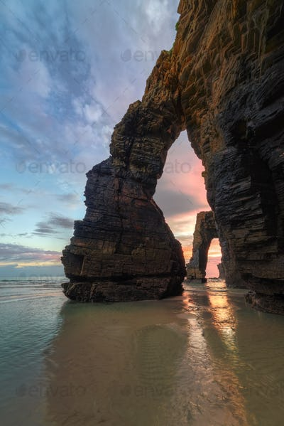 Dawn between the stony arches