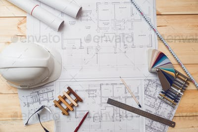 Architecture drawing desk, construction site working with blueprints in the office top view