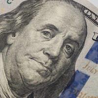 Dollars closeup. Benjamin Franklin's portrait on new one hundred dollar banknote.