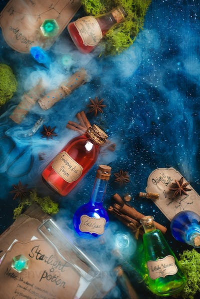 Colorful bottles of magical potions with handwritten labels, steam and oss on a dark wooden