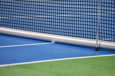 Tennis blue hard court with net before competition
