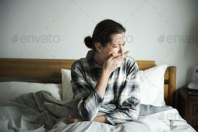 A sleepy woman waking up