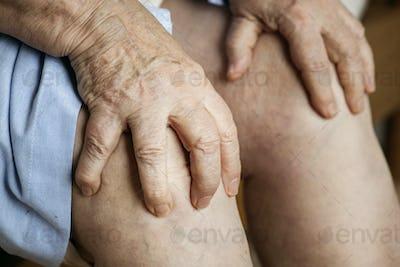 Elderly woman suffering knee pain