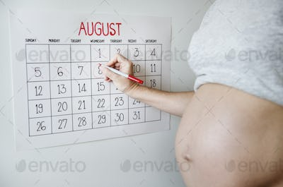 Pregnant woman counting down for delivery date