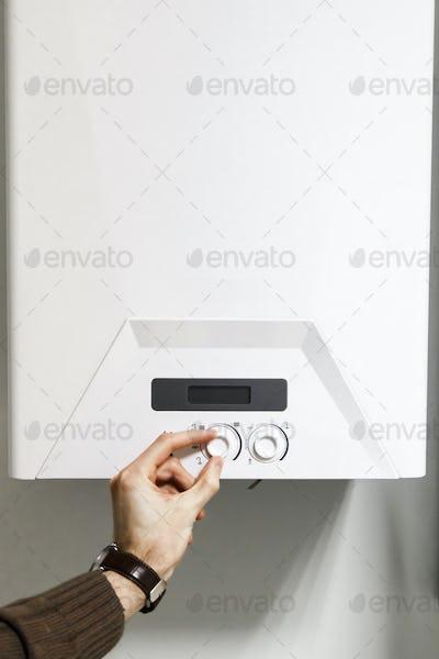 man regulate heating boiler control panel