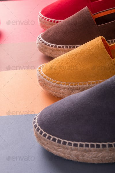 Four pair of espadrilles on multicolor