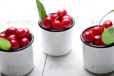 Cherry in enamel cup