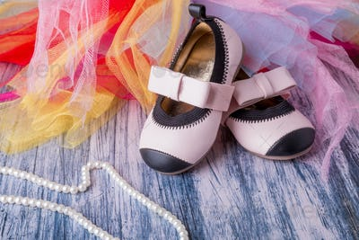 Baby girl pink shoes on colored