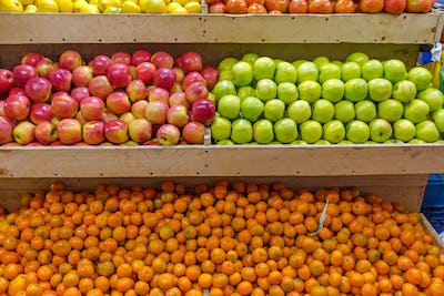 Mandarins and apples for sale