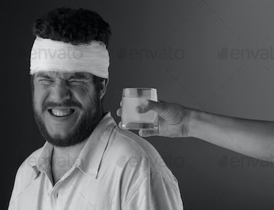 Man with head bandage