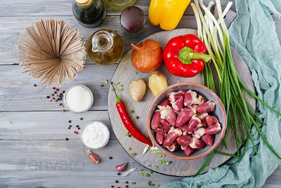 Raw chicken hearts. Ingredients for cooking stir-fry and buckwheat noodles