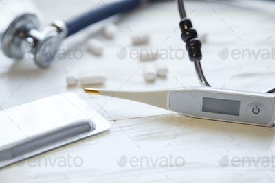 Antibiotics concept. Stethoscope with flu antibiotic and thermometer