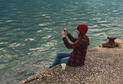 Woman taking pictures with a cellphone