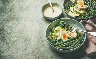 Healthy vegetarian breakfast bowls over grey concrete background, selective focus