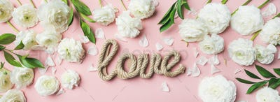 Saint Valentines Day background with ranunculus flowers and word love