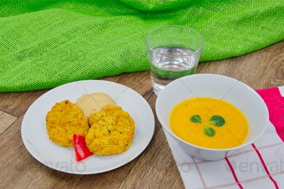 Vegetable slices and pea mash and carrot soup on a table