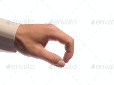 Hand holding some tiny or thin object