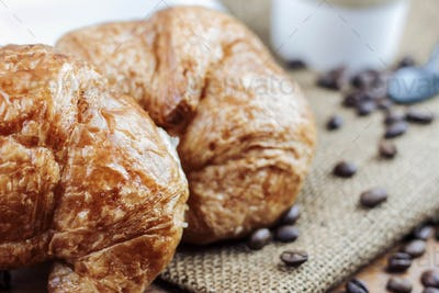 Croissant and coffee on sack