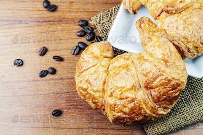 Croissant on on wooden floor