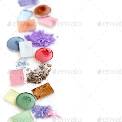 crushed eye shadow isolated on white background with copy space
