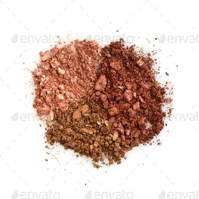 Mixed color eye shadow crushed samples on white background. Top